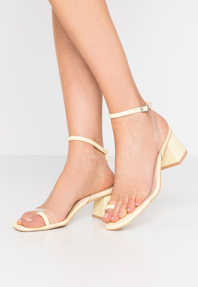 ZENON - T-bar sandals - clear/yellow