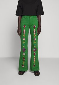 Stieglitz - EVITA PANTS - Flared Jeans - green - 0