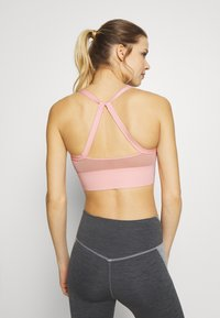 Nike Performance - Sports bra - washed coral - 2