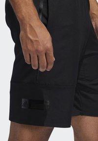 adidas Performance - N3XT L3V3L SHORTS - Sports shorts - black - 6