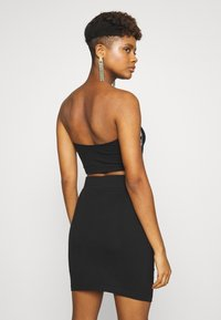 Karl Kani - TAPE TUBE - Top - black - 2