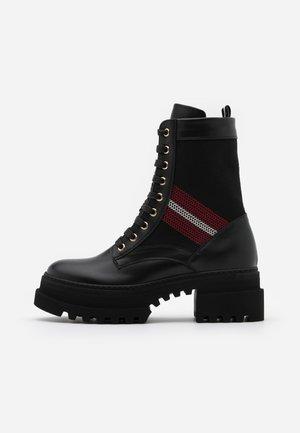 GIOIS - Kotníkové boty na platformě - black