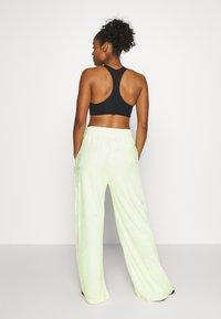 Nike Performance - CITY TRAIN PANT - Tracksuit bottoms - barely volt/spruce aura/reflect black - 2