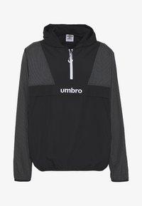 Umbro - DIAMOND REVEAL CAGOULE - Training jacket - black/brilliant white - 3