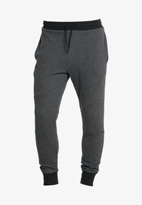 Under Armour - UNSTOPPABLE JOGGER - Tracksuit bottoms - black/black - 5