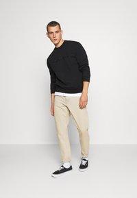 Carhartt WIP - Sweatshirt - black - 1