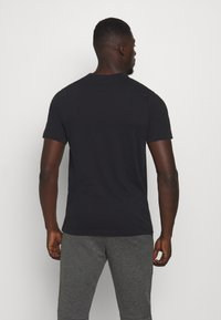 Nike Performance - DRY TEE WILD RUN - Print T-shirt - black - 2