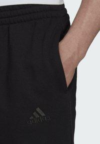 adidas Performance - Tracksuit bottoms - black - 3