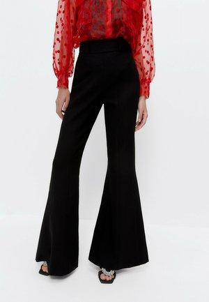 BELL BOTTOM  - Trousers - black
