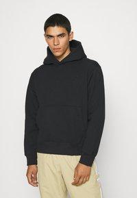 adidas Originals - HOODY UNISEX - Sweatshirt - black - 0