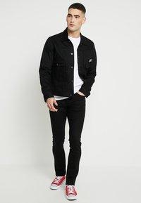 Nudie Jeans - GRIM TIM - Slim fit jeans - dry ever black - 1