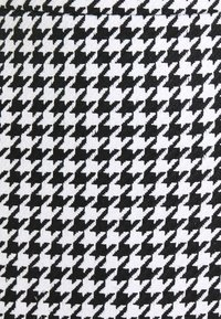 NA-KD - HOUNDSTOOTH SKIRT - A-line skirt - black/white - 2