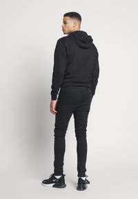 Golden Equation - FADED DISTRESSED MID-RISE - Jeans Skinny Fit - black - 2