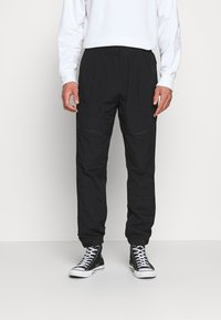 Calvin Klein Jeans - TRACK PANT - Trousers - black - 0