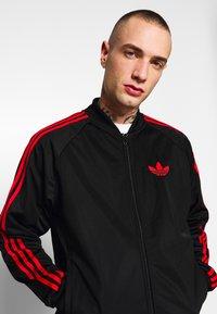 adidas Originals - SUPERSTAR SPORT INSPIRED TRACK TOP - Training jacket - black/red - 3