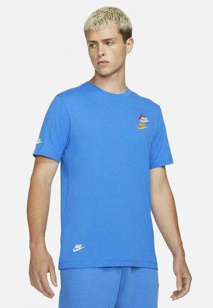 T-shirt med print - signal blue
