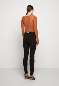 HUGO - HALELI - Leggings - Trousers - black - 2