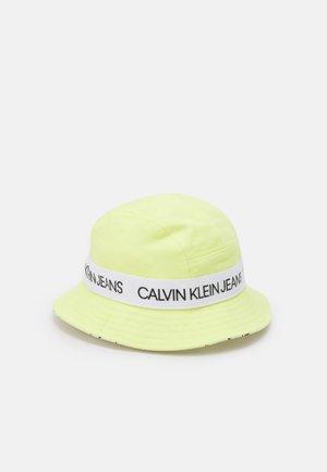 REVERSIBLE LOGO BUCKET HAT UNISEX - Hat - yellow lime