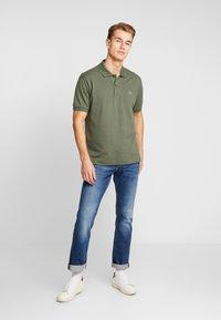 Lacoste - Polo shirt - aucuba - 1