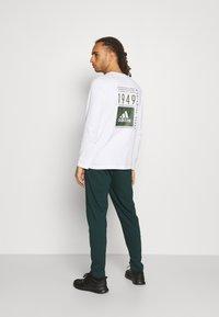 4F - Men's sweatpants - Tracksuit bottoms - dark green - 2