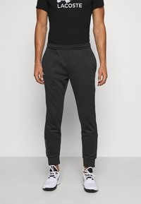 Lacoste Sport - TENNIS PANT - Tracksuit bottoms - black - 0