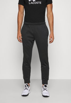 TENNIS PANT - Trainingsbroek - black