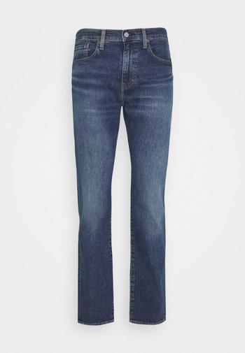 502 TAPER - Slim fit jeans - wagyu moss