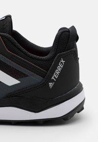 adidas Performance - TERREX AGRAVIC FLOW UNISEX - Zapatillas de senderismo - core black/crystal white/solar red - 5