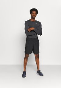 Nike Performance - CHALLENGER SHORT - Sports shorts - black - 1