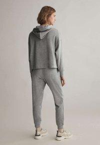OYSHO - Teplákové kalhoty - light grey - 1