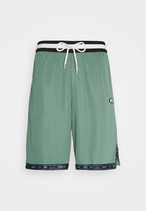 DRY DNA - Sports shorts - dutch green/off noir