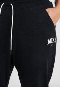 Nike Sportswear - Teplákové kalhoty - black - 4