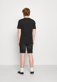 Common Kollectiv - FLORAL UNISEX - Print T-shirt - black - 2