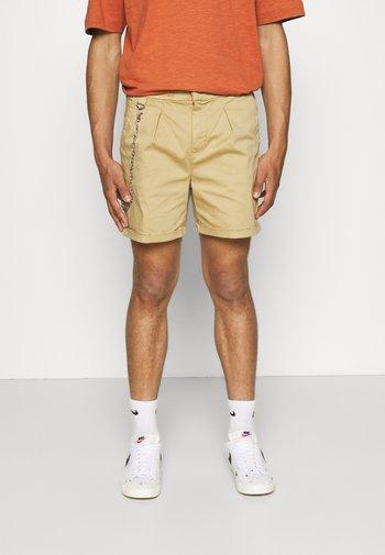 THOMAS - Shorts - sand