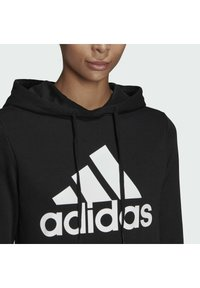 adidas Performance - ESSENTIALS RELAXED LOGO HOODIE - Hoodie - black - 4