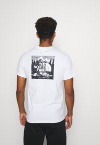 The North Face - REDBOX CELEBRATION TEE - Print T-shirt - white - 2