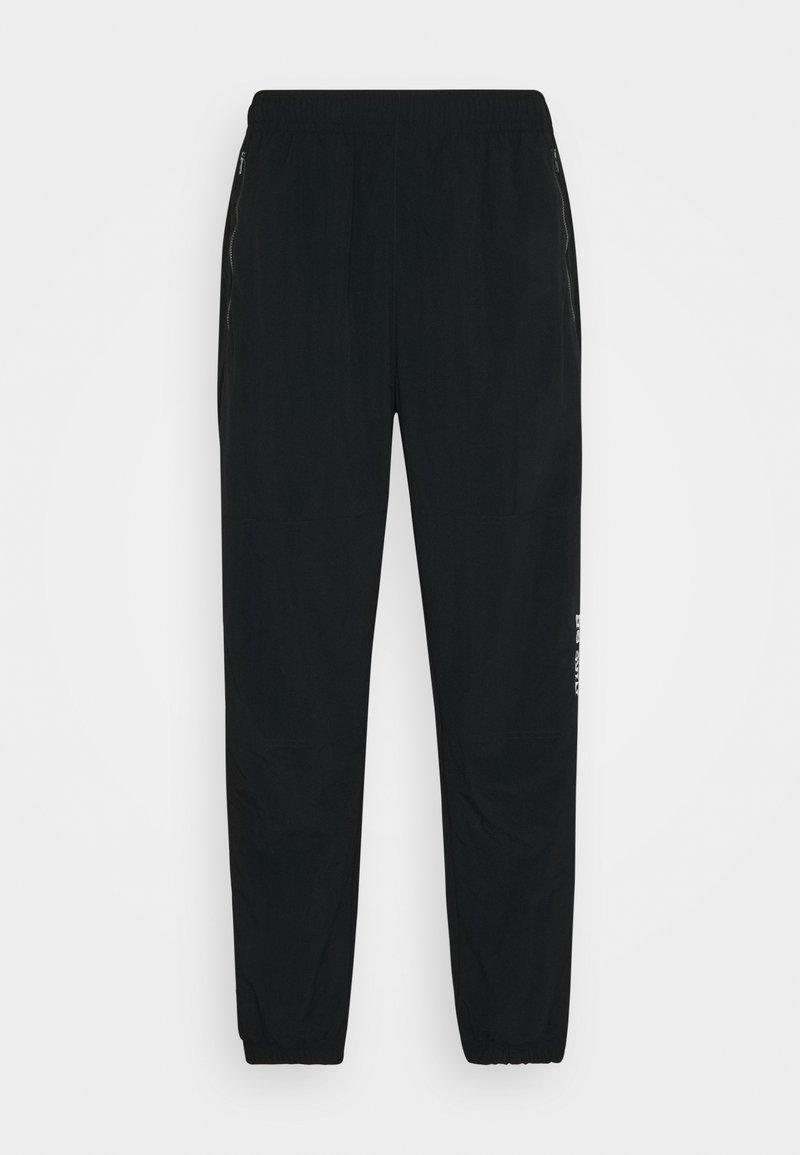 Nike SB - NOVELTY TRACK PANT UNISEX - Tracksuit bottoms - black/white