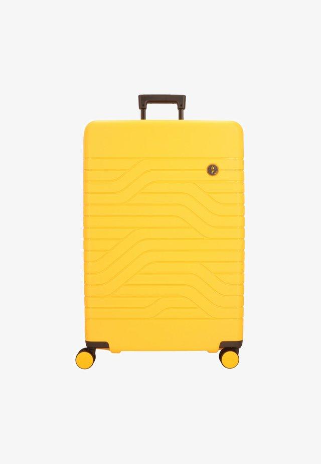 BY ULISSE - Wheeled suitcase - mango