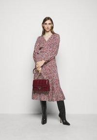 MICHAEL Michael Kors - TIERED WRAP DRESS - Day dress - dark ruby - 1