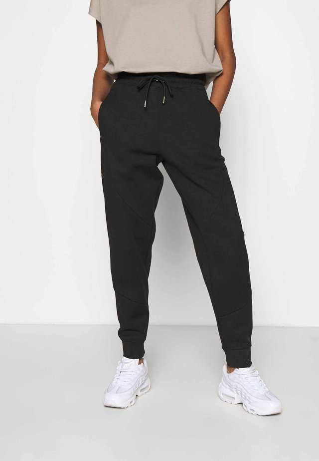 Tracksuit bottoms - black/metallic gold