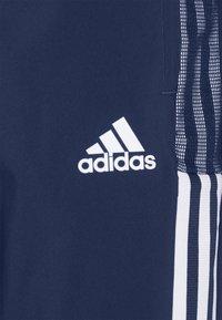 adidas Performance - TIRO 21 - Spodnie treningowe - team navy blue - 4
