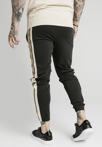SIKSILK - PREMIUM TAPE TRACK PANT - Tracksuit bottoms - black/off white - 2