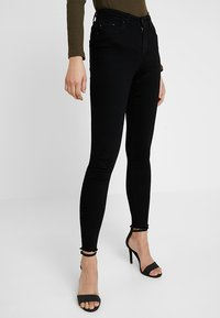 ONLY - ONLBLUSH MID RAW - Vaqueros pitillo - black denim - 0