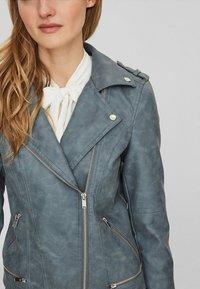 Vero Moda - VMWORLD SHORT - Faux leather jacket - dark blue - 2