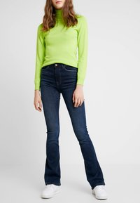 ONLY - ONLPAOLA - Flared jeans - dark blue denim - 0