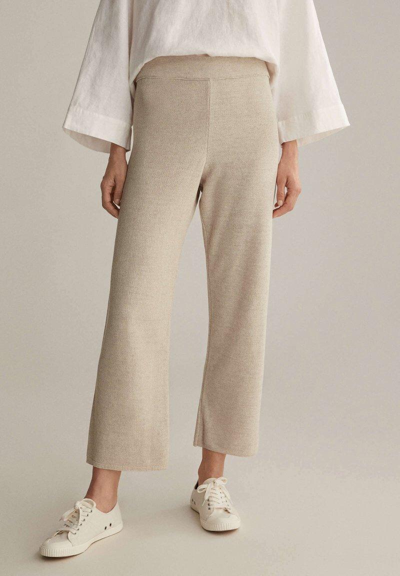 OYSHO - Trousers - beige