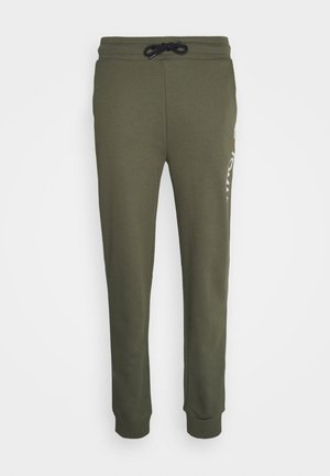LOGO - Pantalon de survêtement - green