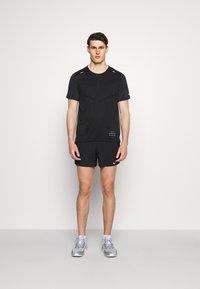 Nike Performance - FLEX - Pantaloncini sportivi - black/silver - 1