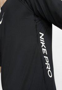 Nike Performance - T-shirts print - black - 4