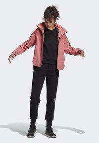 adidas Performance - Waterproof jacket - pink - 1